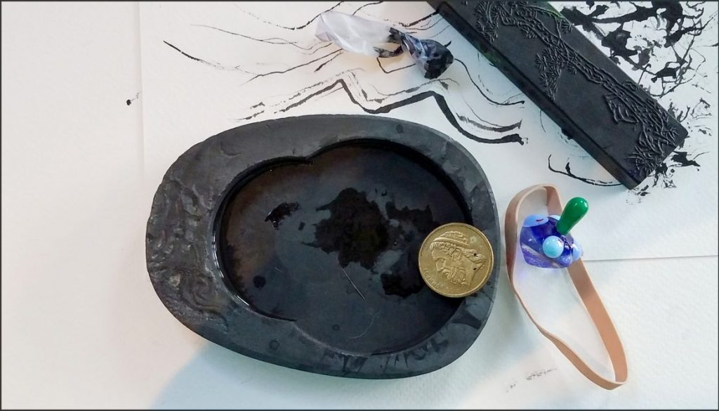 Ink Stone, with Greek coin and dreidel